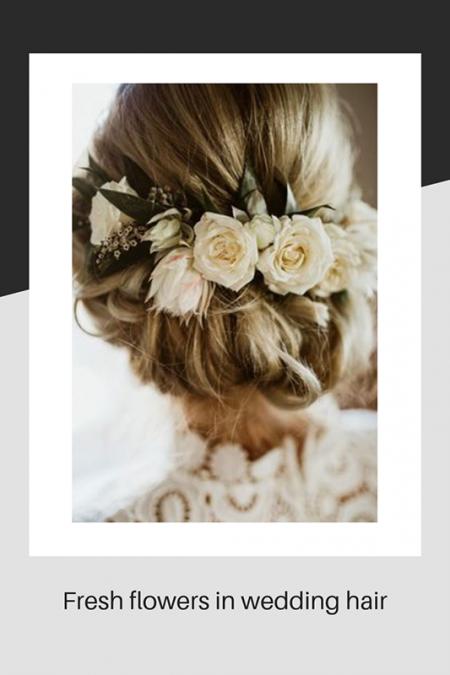 Fresh flowers in wedding hair
