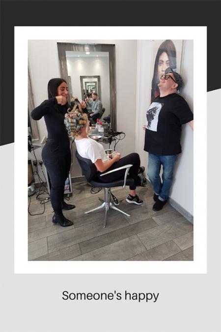 Salon manager happy at photo shoot
