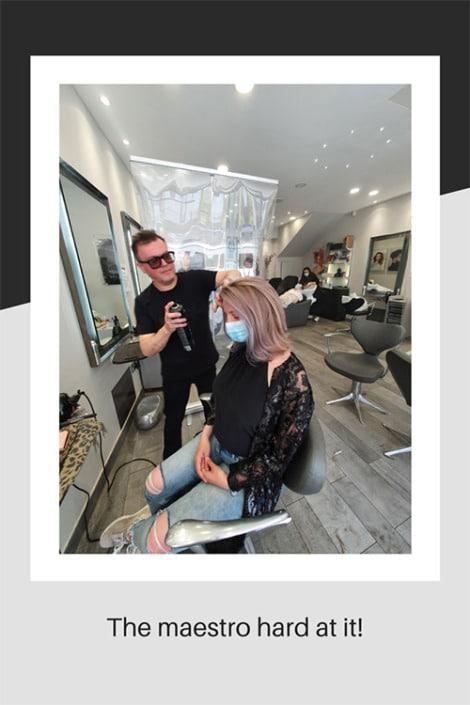Mel, the salon director working hard