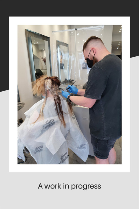 The salon owner hard at work