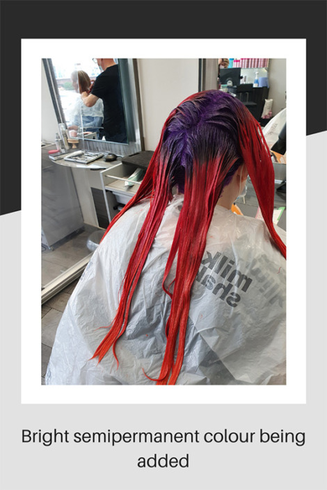 Bright semipermanent hair colour being added